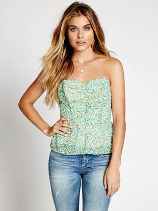 Embrace the carefree vibe of summer in this flirty strapless top from our coveted '90s archives. An allover ditsy floral print, ruffled hem and sexy tie-back instantly up your warm-weather fashion game.