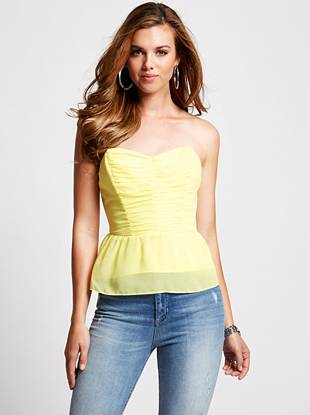 A sexy sweetheart neckline and a playful tie-back design make this top the ultimate fashion essential. Plus, the fitted bodice slims your figure to create an ultra-flattering silhouette you (and everyone else) will love.