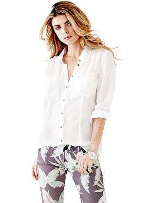 Whether you're heading to work or running around town, look the part in this semi-sheer button down. Wear it tucked in halfway or tied at the waist for a more trend-forward look.