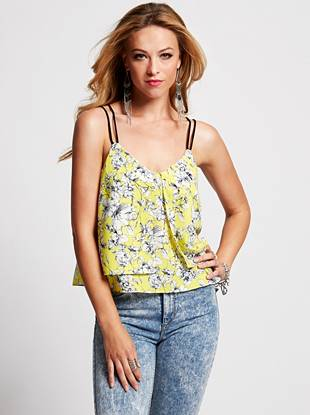 Nothing makes a statement like an eye-catching graphic, and this tank is just what you need to own the style scene. A neutral floral print brings sophisticated appeal and the layered design complements your feminine sense of style.