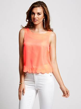 Simply stylish, this breezy tank top offers a sweet surprise. A scalloped hem continues up the center back and is finished with glossy buttons, instantly giving it a modern and feminine touch.