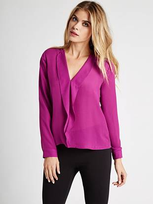Effortlessly versatile, this lightweight top is the your new day-to-night favorite. Feminine ruffles and a sexy back cutout perfectly complement the simple, breezy design.