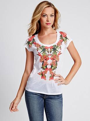 Make a statement while staying casual in this vibrant graphic tee. An exotic floral print and soft, semi-sheer design make it a weekend essential you'll wear all year long.