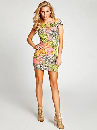 A sexy, body-hugging silhouette, easy-to-wear stretch jersey fabric and playful print make this dress a must for summer. The front cutout adds that little extra touch your style is known for.