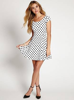 Quintessentially retro and seriously soft, this fit-and-flare dress if perfect for easy, put-together style. With an allover polka-dot print and subtle back cutout detail, this '90s vintage piece keeps you in the fashion know.