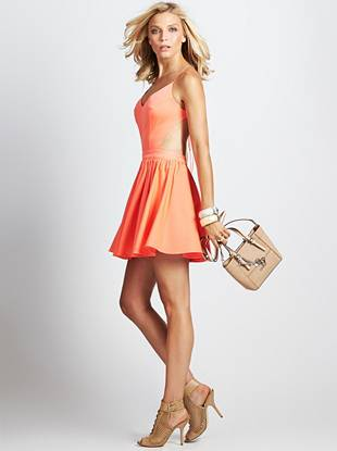 Nothing says flirty like a fit-and-flare dress, and this playful number is the ultimate crowd-pleaser. A sexy open back, revealing side cutouts, and sun-loving shade combine to create a closet essential you'll wear through the summer and beyond.