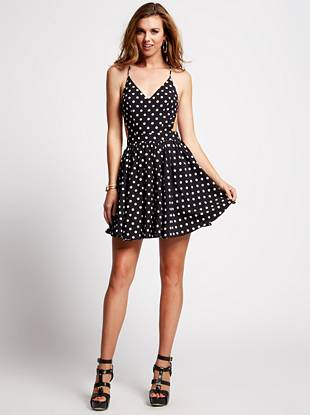 Nothing says flirty like a fit-and-flare dress, and this playful number is the ultimate crowd-pleaser. A sexy open back, revealing side cutouts, and retro polka-dot print combine to create a closet essential you'll wear through this season and beyond.
