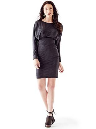 A slinky stretch knit, enviable crocodile texture and sleek coated finish—this dress is far from your average LBD. Layer it for a polished daytime look then wear it solo with sparkling accents after dark for stop-and-stare appeal.