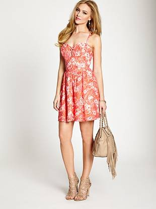 Gorgeous floral-print lace and vibrant color team up to create one of the season's most covetable looks. Its ultra-flirty silhouette and a touch of feminine attitude make it the ultimate sexy-yet-sweet dress.