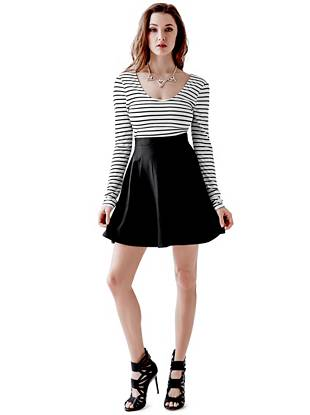 Go from shopping days to Saturday nights in this never-failing fit-and-flare dress. The striped top features a back cutout for added allure and the playful flared skirt flatters every body type.