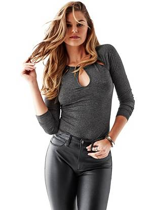 Trend forward and statement making, this long-sleeve top keeps you looking sexy through the cooler seasons. Skin-revealing cutouts and faux-leather trim make it perfect for spontaneous nights out.