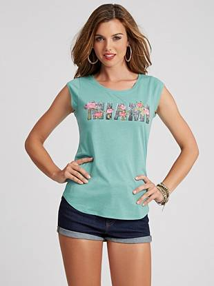 In the mood for some Miami heat? Live vicariously through this floral-print Miami graphic tee.