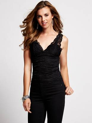 Undoubtedly sexy, this camisole is a key layering piece to have in your closet. Luxurious lace and a low-cut V-neck work together to create a look that's both sophisticated and seductive.