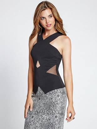 A modern crossover design and skin-revealing cutouts deliver tempting edge to this ultra-sexy top. Perfect for a night out, it makes a daring, on-trend impression.