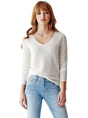 Enviable texture and a playful sweetheart detail instantly elevate this basic V-neck sweater.