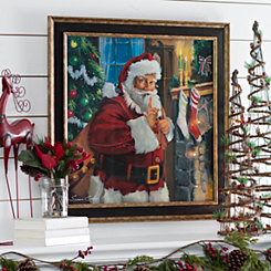 Santa Filling Stockings Framed Art Print