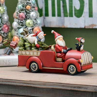 Driving Santa Statue