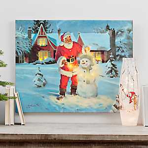 Santa Building a Snowman LED Canvas Art Print