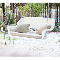 White Wicker Porch Swing with Tan Cushion