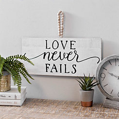 Love Never Fails Wall Plaque