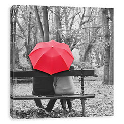 Couple Sitting Under Umbrella Canvas Art Print