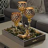 Gold Honeycomb Charismas, reindeer and string light centerpiece