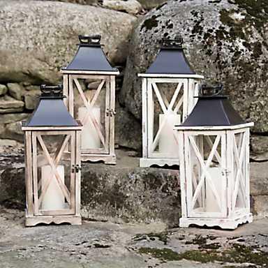 4 lanterns displayed on big bolders for some reason
