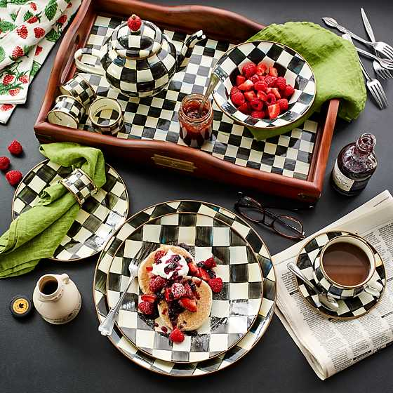This Courtly Check Enamel Charger Plate from MacKenzie-Childs does just that. The layers of pattern add dimension to your table setting from the plate ... & How To Use Plate Chargers