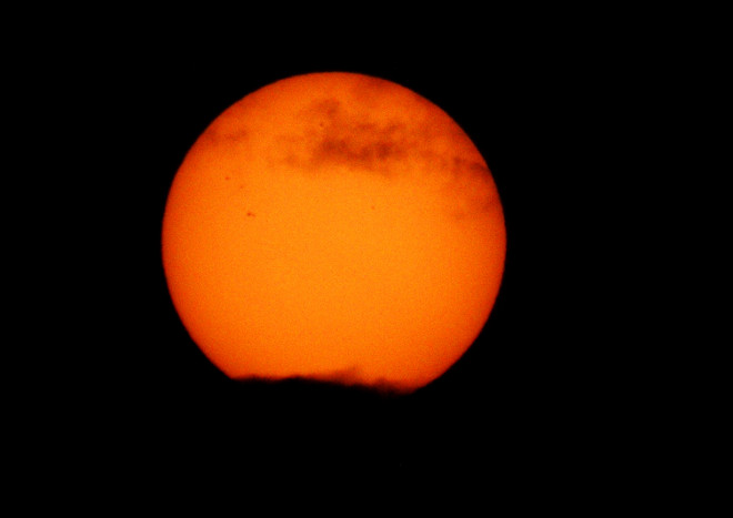 Sun with Clouds and Sunspots