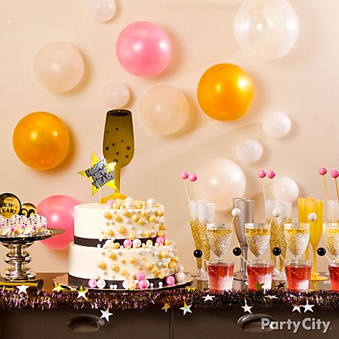 New year 39 s eve party ideas in black and gold party city for Champagne balloon wall