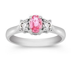 Oval Pink Sapphire and Diamond Three-Stone Ring