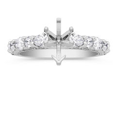 Pear Shaped and Round Diamond Engagement Ring