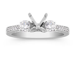 Three-Stone Round Diamond Engagement Ring with Pave Setting in Platinum