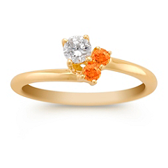 Round Orange Sapphire and Diamond Three-Stone Ring