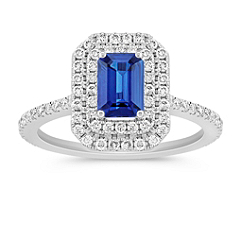 Halo Emerald Cut Sapphire and Round Diamond Ring