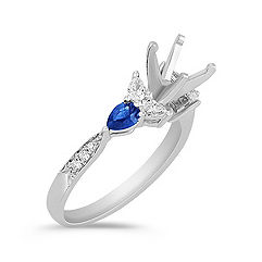Pear-Shaped Sapphire and Pear-Shaped and Round Diamond Engagement Ring
