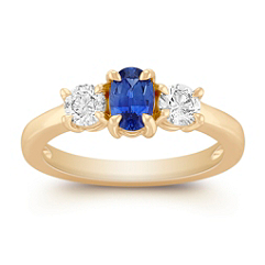 Oval Sapphire and Round Diamond Three-Stone Ring