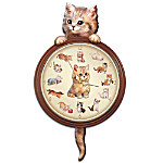 Spend every hour in the company of kittens with this adorable collectible cat art wall clock! This finely crafted ceramic clock is framed by a classic beveled-edge wood frame with golden trim. But best of all, each hour on this decorative wall clock is represented by internationally acclaimed artist Jurgen Scholz's cat art, and the entire clock is embraced by a darling sculptural kitty whose tail moves as time ticks by! Available exclusively from the Bradford Exchange, this unique wall clock also boasts an accurate quartz movement, golden hands, and a glass-covered face. All in all, it adds up to 24 hours of fun each day! It would be difficult to find a more unique kitten and cat lover gift idea, for yourself or a fellow cat-fancier, so don't wait! Order now!