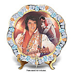 Elvis Presley® - he was the prize gem of all Rock 'n' Roll legends, and no other superstar has so perfectly dazzled us since! His Las Vegas performances were legendary, mesmerizing crowds with his stage presence and spectacular costumes. Now, remember Elvis'®s remarkable Vegas performances forever with this limited-edition Elvis collector plate featuring the portraiture of acclaimed artists Nate Giorgio and Bruce Emmett.Officially authorized by the Elvis Presley Estate and available exclusively from The Bradford Exchange, this impressive Elvis Presley plate is handcrafted of fine porcelain and boasts a platinum-edged, scalloped border set with shimmering simulated gems. Montage imagery of Elvis in one of his amazing jewel-encrusted jumpsuits is highlighted by his replica signature and a sparkling, fully dimensional TCB® emblem. Perfect for your Elvis collection or a thrilling Elvis fan gift, but intense demand is expected - order now!