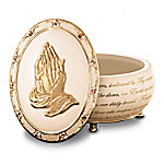 "Knowing that your cares are in the hands of the Lord brings great comfort and peace. Now you can embrace your faith through the power of prayer with this limited-edition Heirloom Porcelain® prayer music box, exclusively from The Bradford Exchange. This collectible music box will lift your spirits as it plays the melody, ""The Lord's Prayer.""This inspiring prayer music box, ""The Lord's Prayer,"" is crafted of Heirloom Porcelain® with gold-enhanced feet and features the enduring image of the ""The Praying Hands"" in a bas-relief sculpture adorned with gold. A continuous script of ""The Lord's Prayer,"" Swarovski crystals and 22K gold accents add more delight. Plus, this meaningful collectible comes with slips of parchment paper to write your personal prayers and store them inside the box. Makes a thoughtful religious gift. High demand is expected. Order now!California Residents click here for Proposition 65 notice."