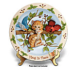 "Sometimes, no matter how hard you try, life leaves you hanging on by a thread. It's times like these when a little laughter can help remind you to just hold on tight - brighter days are head. Now, you can celebrate hope and optimism with this humorous kitten-themed collector plate, exclusively from The Bradford Exchange.This darling collector plate is handcrafted in artist's resin and features an adorable hand-sculpted kitty hanging on a tree branch surrounded by richly-dimensional, raised-relief songbirds. The decorative rim is lavished with bright berries, pretty green leaves and a lovely butterfly, all hand-painted for delightful detail. Plus, this uplifting collectible includes the sentiment, ""Hang In There."" Great to give as a cheerful cat lover's gift. Limited-edition, so heavy demand is expected. Order now!"