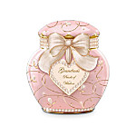 "A grandmother's wisdom and love for her granddaughter are more precious than any jewel. Now, you can uniquely share the benefits of your life lessons and show her how much she means to you with this beautiful Grandma's Pearls of Wisdom Heirloom Porcelain® music box for granddaughter. This elegant musical ginger jar holds a whole year of messages from you, tucked inside a classic keepsake design your granddaughter will treasure.Handcrafted of Heirloom Porcelain by the skilled artisans under the hallmark of Longton Crown exclusively for The Bradford Exchange, this charming musical treasure has 365 messages inside, elegantly printed on fine parchment, so that your granddaughter can select your wise, witty and warm messages - your ""pearls of wisdom"" - once each day for a whole year of wishes. This ginger jar music box for granddaughter is arrayed with dozens of hand-glazed porcelain ""pearls"" and hand-decorated in 22K gold scrollwork, then tied up with a mesh fabric bow with golden trim. Plus, this keepsake music box plays the uplifting melody ""Always in My Heart."" This music box for granddaughters makes such a thoughtful and meaningful gift, and strong demand is expected for this limited-edition treasure. Order now!"