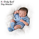 Let's hear it for the boys! It's naptime for Charlie, who's been passed all afternoon from doting grandmother to grandfather to aunts and uncles. Now, you can enjoy a snoozing bundle of boy in a collectible miniature baby boy doll created in an amazing 10-inch size!You'll experience a most delightful case of the blues when you see this tiny lifelike baby doll, available exclusively from The Ashton-Drake Galleries. Acclaimed Master Doll Artist Linda Webb's realistic sculpt has been exactingly reproduced in a miniature baby boy doll that has RealTouch™ vinyl skin, a thick headful of brown hair, wispy eyelashes and hand-painted features. Strong demand is expected, and you won't want to miss out. Order now!