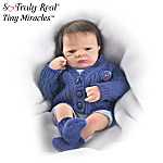 What a darling blue-eyed baby boy! This Special Edition Tiny Miracles™ Little Charlie has his eyes wide open, eager to see the new world around him - and you may be the first person he sees! You'll love gazing into the wondrous eyes of this amazing 10-inch collectible miniature baby boy doll - he's sure to help you see the world anew.This lifelike baby boy doll is by acclaimed Master Doll Artist Linda Webb, and is available exclusively from The Ashton-Drake Galleries. He has RealTouch™ vinyl skin, a headful of thick brown hair, and hand-painted features. And who could miss those big blue eyes with their wispy eyelashes! Don't wait, Charlie's sure to inspire lots of longing gazes, and strong demand is expected. Order now