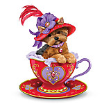 """She's always ready for a spot of tea. Join this Yorkie teacup figurine who makes a sassy statement just brimming with """"personali-tea!"""" This pampered pooch sits inside an intricately detailed red and purple teacup, on a sculpted bed of pearlescent """"fabric."""" You won't be able to resist her big brown eyes and cute head tilt. And she's adorably accessorized with a sparking simulated """"ruby"""" studded collar and a big red, wide-brimmed hat featuring a real feather. This exclusive Hamilton Collection Yorkshire Terrier collectible figurine is meticulously handcrafted and hand-painted with a shiny finish, then adorned with raised golden and pearlescent accents and more than 15 beautifully faceted hand-set simulated rubies. Strong demand is expected for this limited-edition collectible, so order now!"""