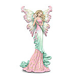 "This glorious breast cancer support fairy figurine encourages us to open your hearts to a brighter future for those fighting breast cancer. With her butterfly wings, flowing gown and serene expression, she radiates hope! A portion of the proceeds will be donated to help raise breast cancer awareness and fund research. Figurine comes with a FREE matching butterfly pin with a pink awareness ribbon and the word ""Hope."" Enjoy a message of promise with this limited-edition breast cancer support figurine, only from The Hamilton Collection. Handcrafted of artist's resin, figurine is lovingly hand-painted for the ultimate in detail, including ruffled wings accented with golden metallic paint and a pink ribbon on her gown. But hurry, since demand is expected to be heavy. Order now!"