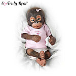 These first-ever So Truly Real® collectible monkey dolls are masterpieces of sculpting that truly rival Mother Nature! This sweetheart of a collection begins with Issue One, Little Umi with FREE pacifier. Soon, your collection will continue with Issue Two, Little Risa and additional issues of collectible orangutan dolls, each a separate issue, to follow.‡An exclusive collection from The Ashton-Drake Galleries by Master Doll Artists Wendy Dickison and Melissa McCrory, a portion of the proceeds from your purchase of these So Truly Real® monkey dolls will be donated to support rainforest preservation. These collectible orangutan dolls feature heads and limbs crafted of collector-quality vinyl and soft-to-the-touch silicone that recreate every realistic detail. Monkey baby dolls have tender, trusting eyes, dark lashes and wisps of hand-applied red hair and are highly posable and adorably costumed. Heavy demand is expected, and you don't want to miss out. Order now!