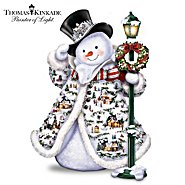 The Bradford Exchange Thomas Kinkade Midwinter Magic Sculpture: Snowman With Illuminated Village Buildings at Sears.com