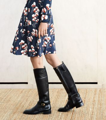 Riding boots with dresses are a great holiday party style choice
