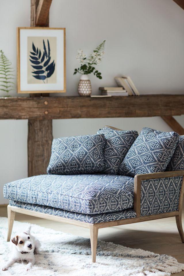Indigo print on chaise chair and fern wall art in a rustic modern room - Anthropologie. #modernrustic #indigoblue #interiordesign